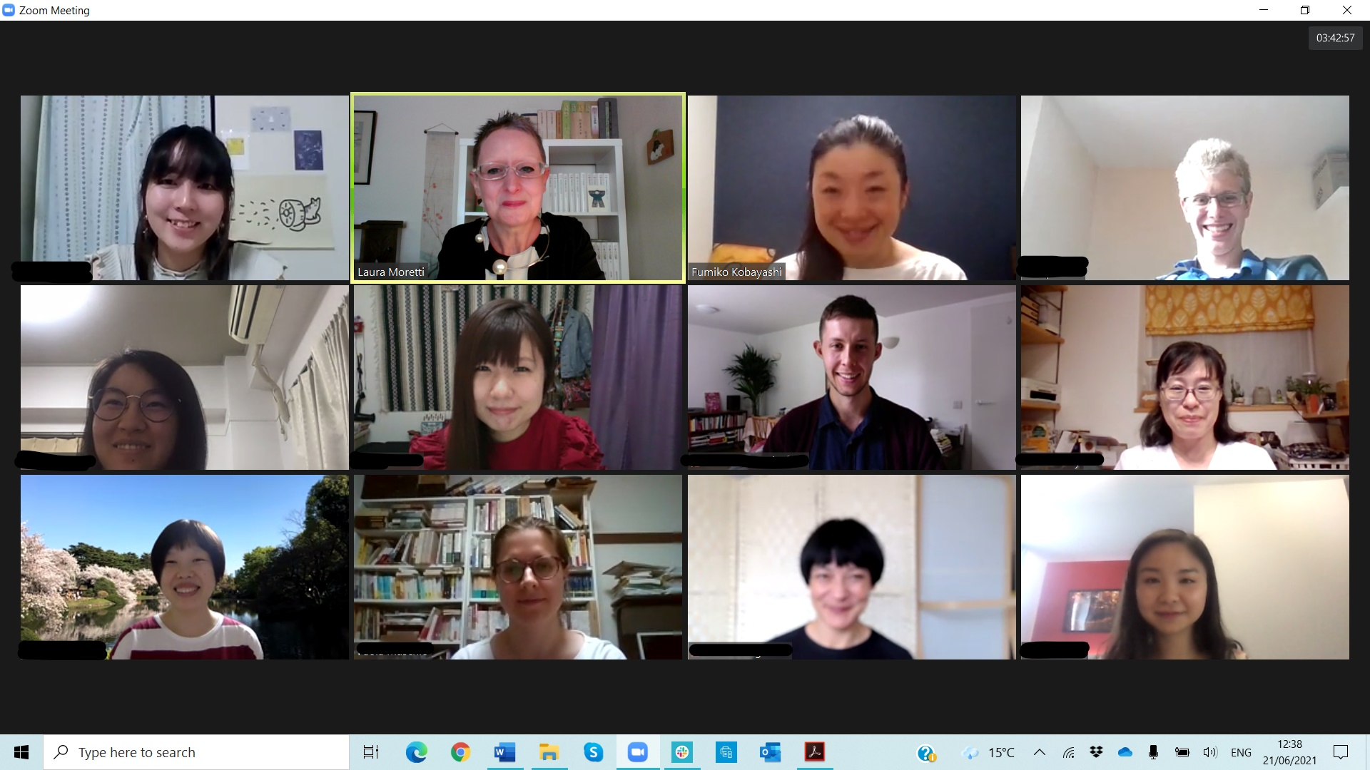 Image shows screenshot of Zoom meeting with 3 rows of participants, smiling